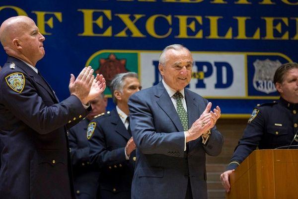 New York Police Commissioner William Bratton, right, along