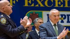 New York Police Commissioner William Bratton, right, along