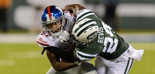 New York Jets cornerback Darrelle Revis tackles New