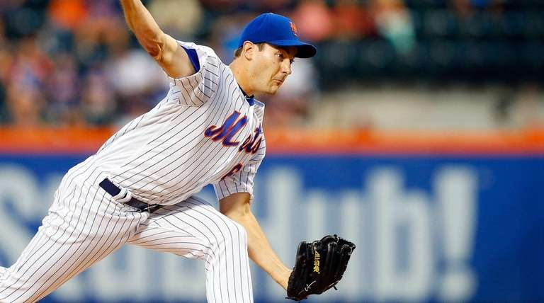 Seth Lugo pitches in the first inning against