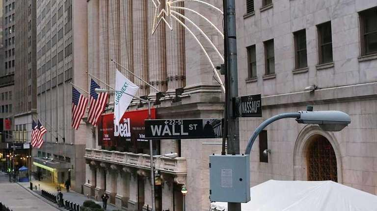 People walk by the New York Stock Exchange