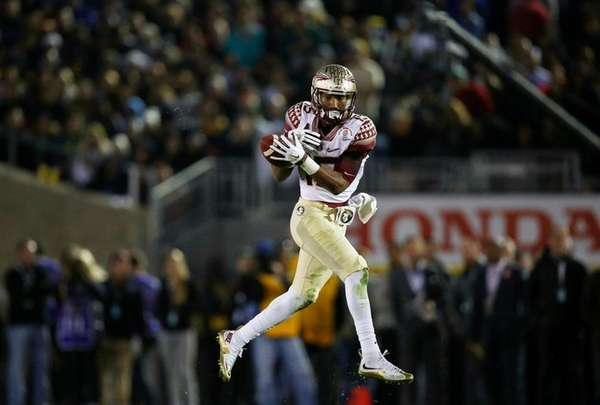 Florida State wide receiver Travis Rudolph tries to