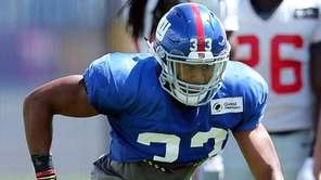 Giants defensive back Andrew Adams runs a defensive