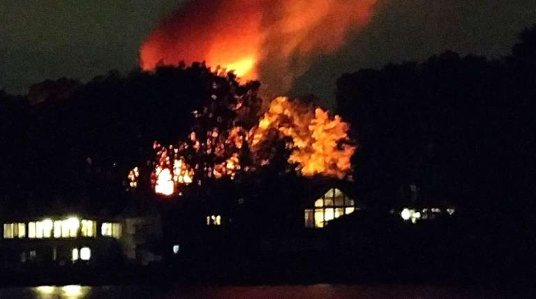 Firefighters from several North Shore departments responded to