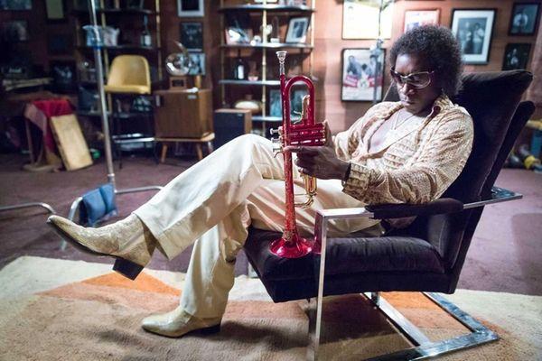 Don Cheadle plays jazz legend Miles Davis in