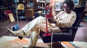 Don Cheadle plays jazz legend Miles Davis in