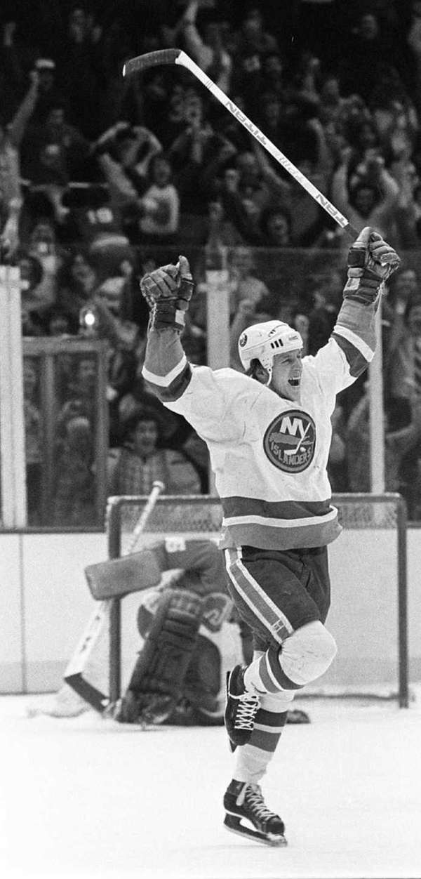 Mike Bossy of the Islanders jumps with joy