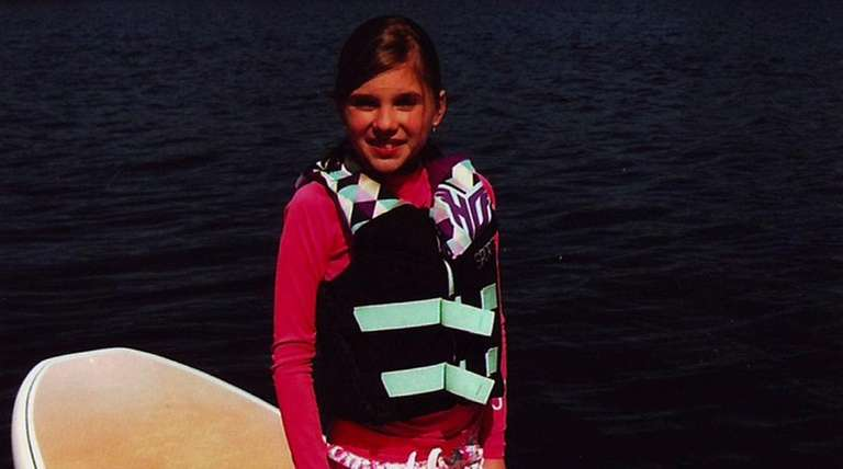Kidsday reporter Lily Coan on her paddleboard.