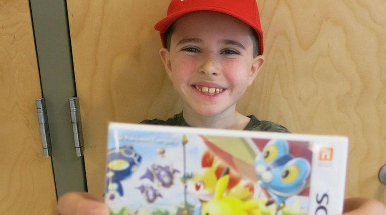 Kidsday reporter Joseph Malossi with the Nintendo 3DS