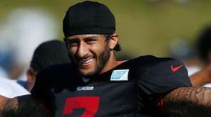 San Francisco 49ers quarterback Colin Kaepernick stretches before