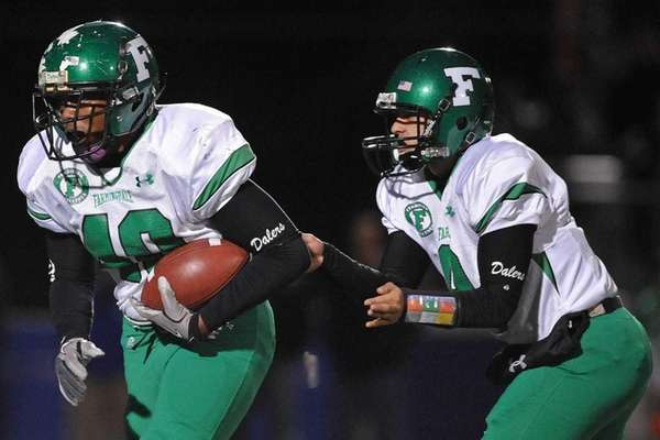 Farmingdale running back Kevin Eversley, left, takes a