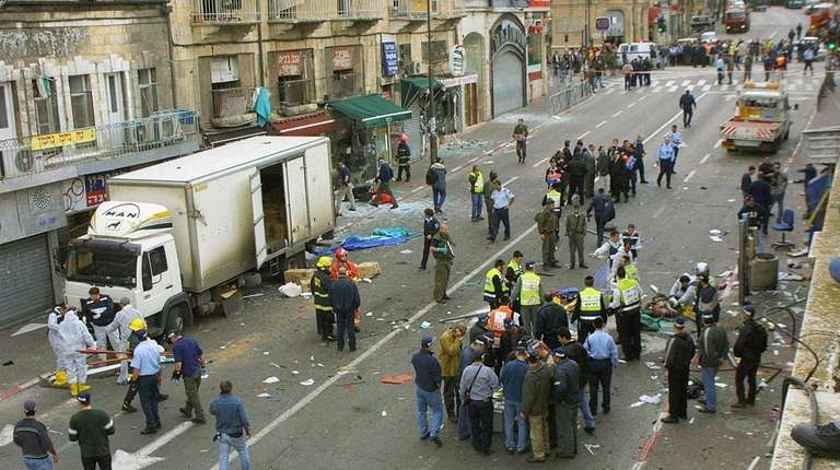 Authorities investigate a 2002 Jerusalem bombing. A federal
