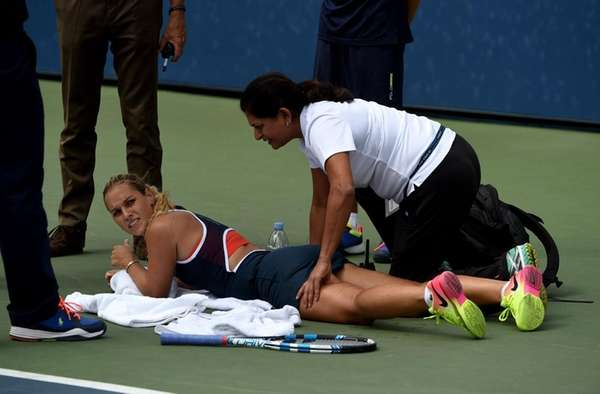 Dominika Cibulkova of Slovakia gets medical attention on