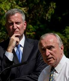 Police Commissioner William Bratton, right, with Mayor Bill