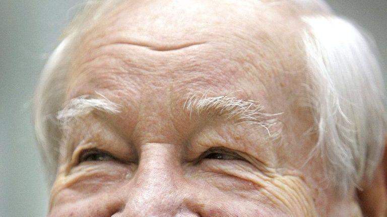 Former Boeing jumbo jet designer Joe Sutter smiles