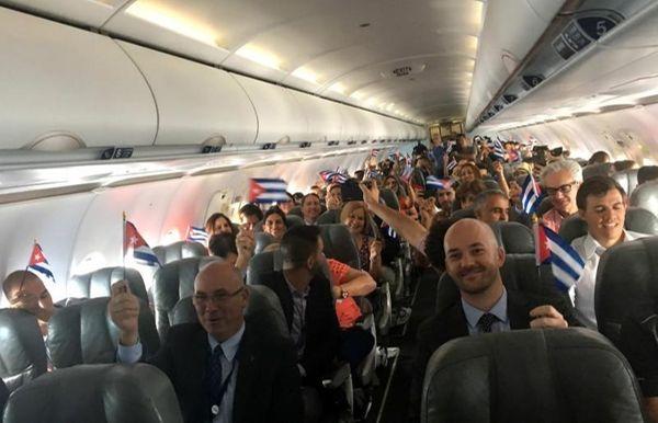 JetBlue flight 387 passengers hold up representations of