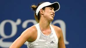 Garbine Muguruza of Spain reacts during her match