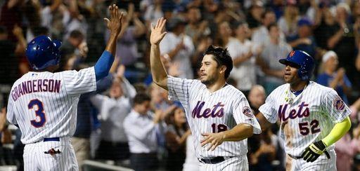 New York Mets' Curtis Granderson greets Travis d'Arnaud