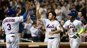 New York Mets' Curtis Granderson greets Travis d'Arnaud