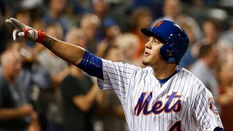 Wilmer Flores reacts after hitting two-run homer in