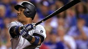 New York Yankees' Starlin Castro watches his three-run
