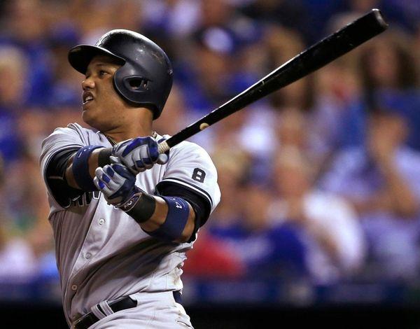 New York Yankees' Starlin Castro watches his three-run