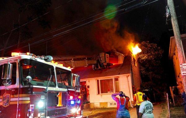 Firefighters battle a blaze Wednesday night, Aug. 31,
