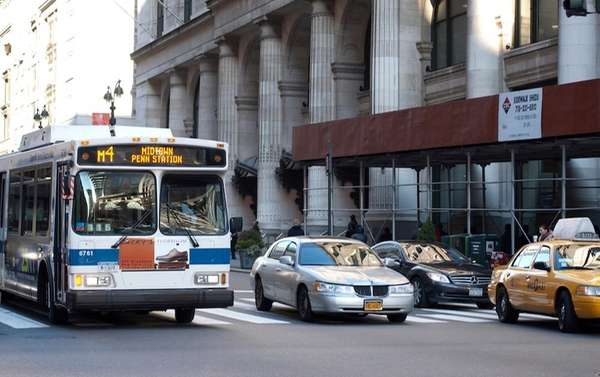 Bus, private cars and taxi sharing a New