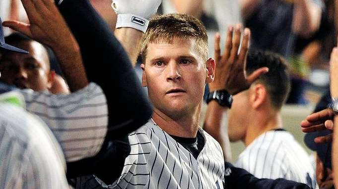 Yankees third baseman Chase Headley is congratulated after