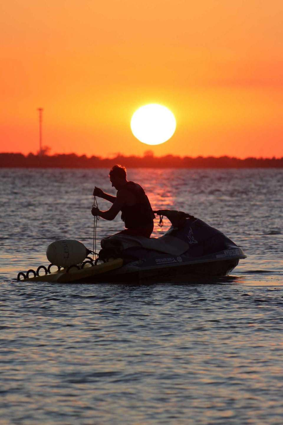 Jet ski in Great South Bay at sunset