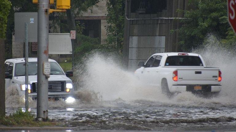 Vehicles splash through at least 2 feet of