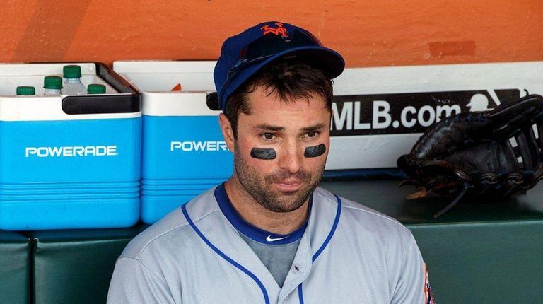 Neil Walker of the Mets sits in