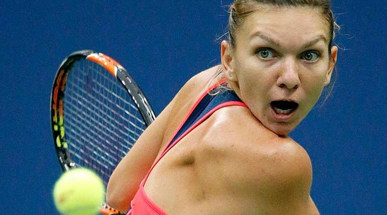 Simona Halep readies the backhand against Lucie Safarova