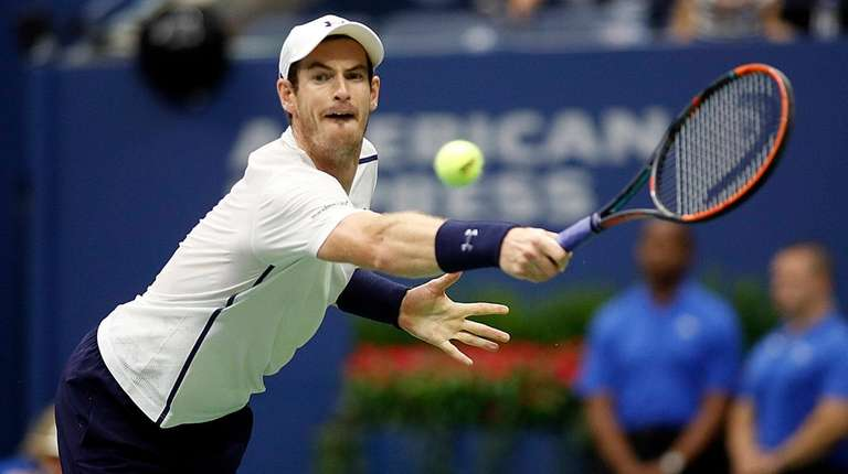 Andy Murray reaches for the backhand return against