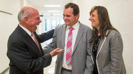 Left to right, attorney Thomas Killeen and parents