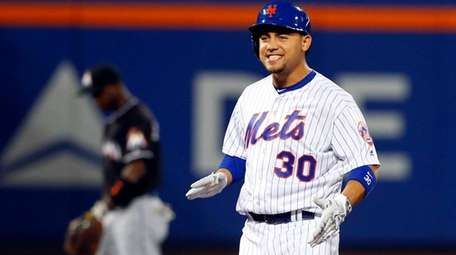 Michael Conforto reacts to his second-inning double against