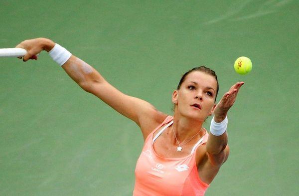 Poland's Agnieszka Radwanska serves to United Kingdom's Naomi