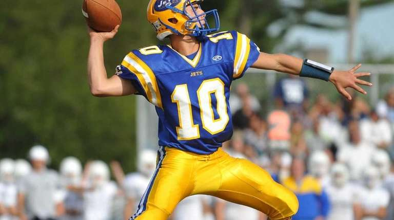 East Meadow's Anthony LaRosa throws a pass for