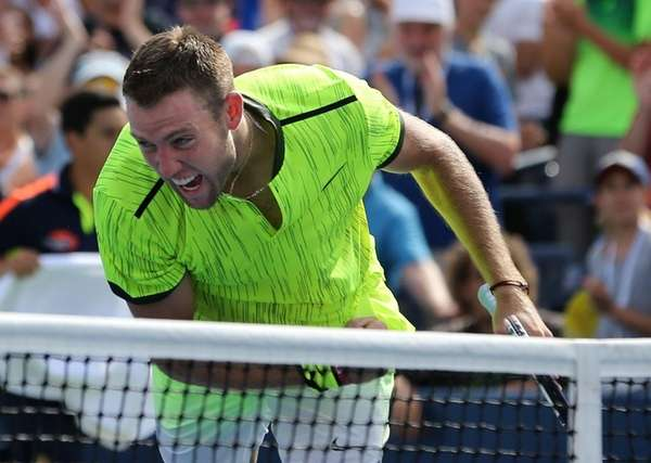 Jack Sock, of the United States, reacts after