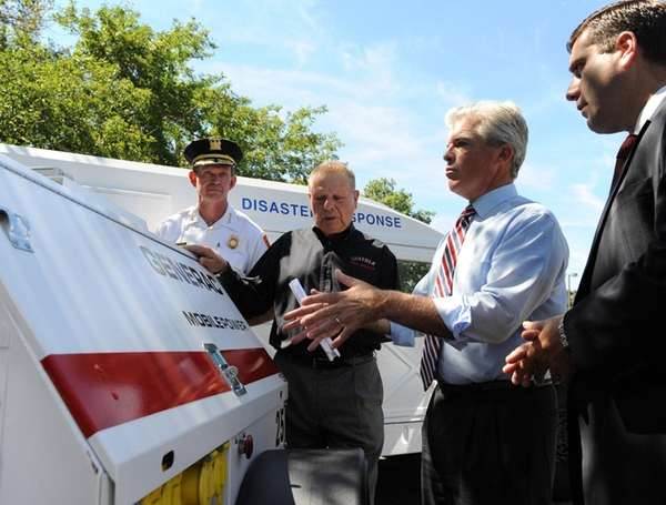 Suffolk County Executive Steve Bellone looks over a