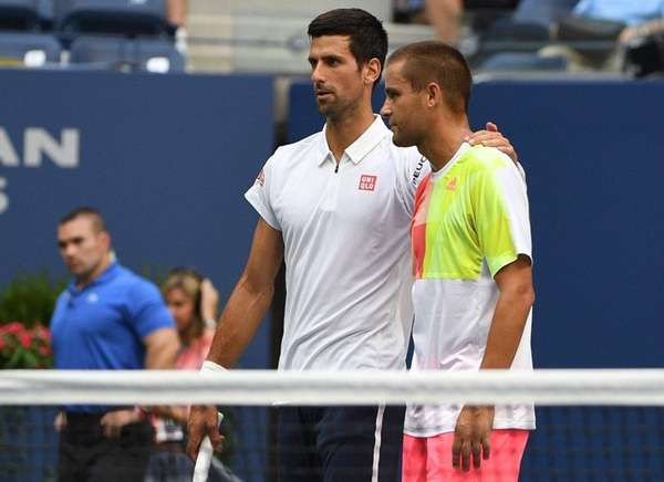 Novak Djokovic of Serbia is seen with Mikhail