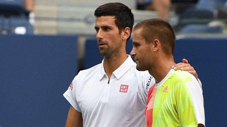 Novak Djokovic of Serbia is seen with Mikhail