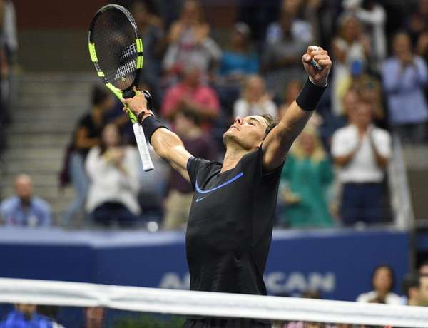 Rafael Nadal of Spain reacts after he wins