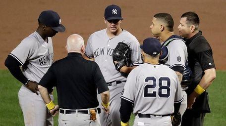 New York Yankees starting pitcher Chad Green, center,