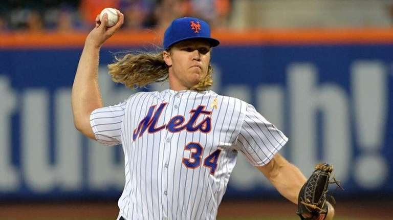 Noah Syndergaard pitches for the Mets against the