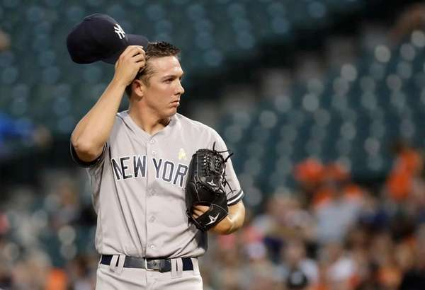 New York Yankees starting pitcher Chad Green pauses