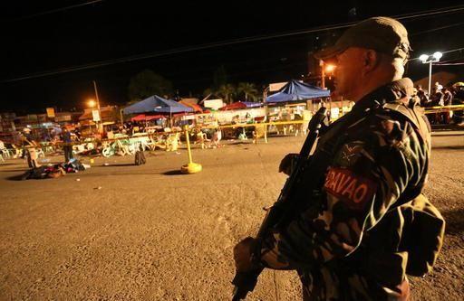 A Philippine soldier keeps watch at a blast
