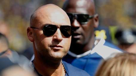 Former New York Yankee Derek Jeter looks on