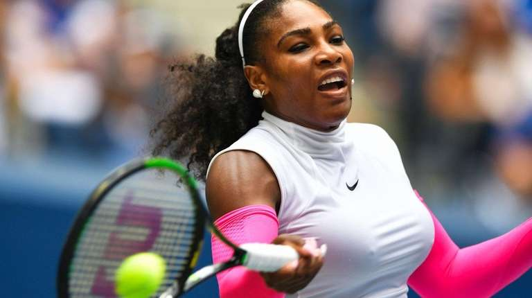 Serena Williams of US hits a return to