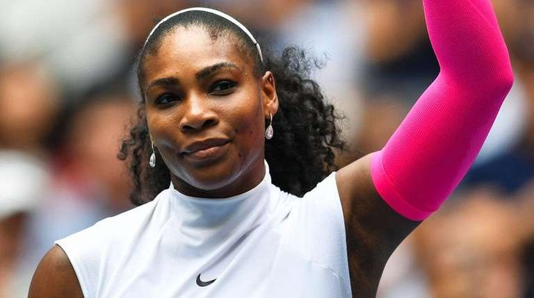 Serena Williams of US celebrates after defeating Johanna